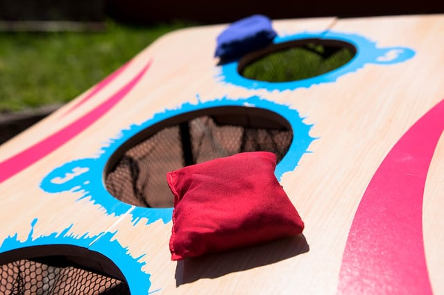 red and blue cornhole bags