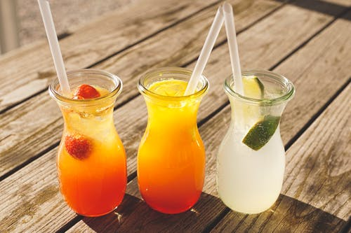 assorted fruit juice on the glass