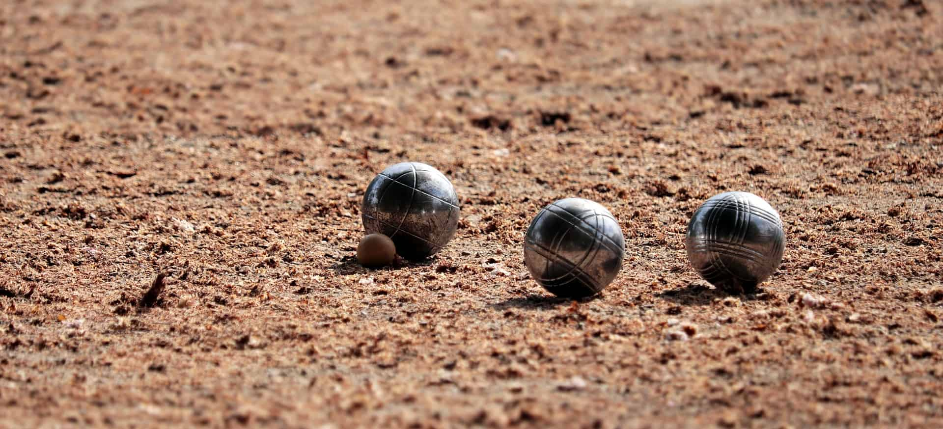 2 bocce ball at the ground