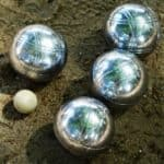 4 bocce balls and one small white ball
